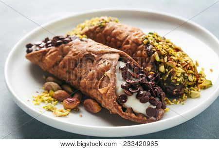 Cannoli With Ricotta, Chocolate And Pistachios. Italian Pastries Of The Sicily . Classic Breakfast W