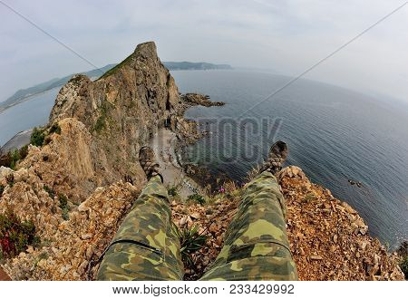 Legs Above Cliff, Extreme Sitting On The Mountain Above Beautiful Bay