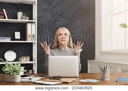Young Furious Woman Working On Laptop, Sitting With Raised Hands And Rolled Eyes Asking For Patience