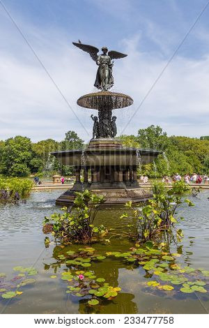 New York, NYC, USA-August 28, 2017: Manhattan NYC Central park at Bethesda Arcade terrace by fountain, angel statue, sunny day.