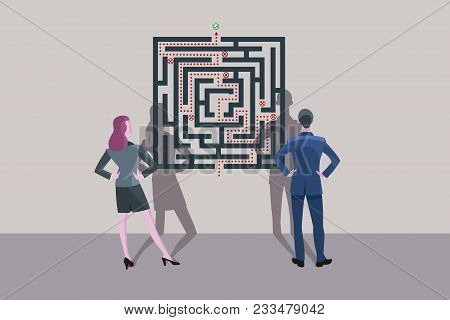 Business Man And Business Woman Standing In Front Of A Labyrinth Plane. They Are Looking For The Sol