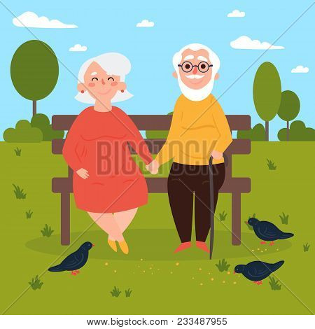 Elderly Couple Outdoors. Grandparents Are Sitting On A Bench In The Park And Feeding Pigeons. Old Co