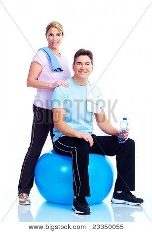 Glücklich lächelnd Fitness-Paar. Over white background
