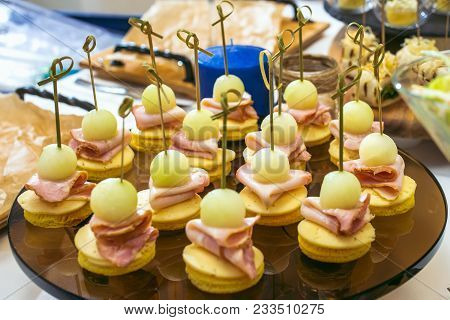 Beautiful Decorated Catering Banquet Table With Different Food Snacks And Appetizers. Canape Plate W