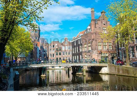 Amsterdam, Netherlands - April 19, 2017: Classical View Of Traditional Buildings At The Canal Side I