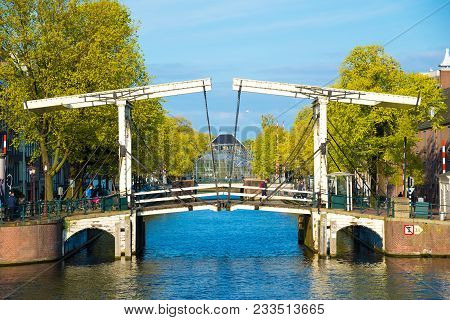 Amsterdam, Netherlands - April 19, 2017: Drawbridge In The Capital Of The Netherlands, Amsterdam