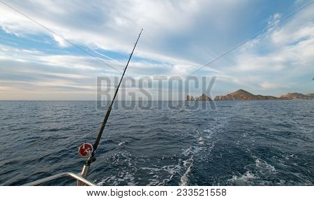 Fishing Rod On Charter Fishing Boat On The Sea Of Cortes / Gulf Of California Viewing Lands End At C