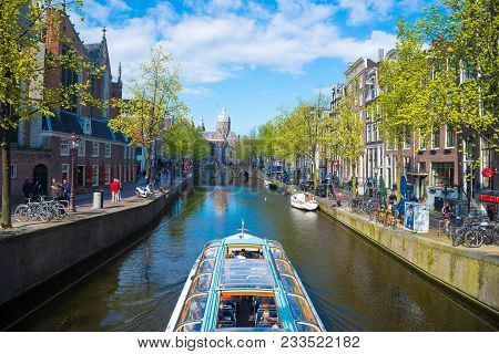 Amsterdam, Netherlands - April 19, 2017: Cruise Ship In Canal At Amsterdam, Netherlands. Beautiful S
