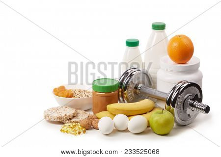 Sports  nutrition (supplements), healthy food and dumbbells isolated on a white background. Fitness, sport and healthy lifestyle concept.
