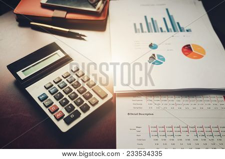Accounting Basic Tools. Calculator, Smartphone, Notebook,  On White Table For Startup In Today.