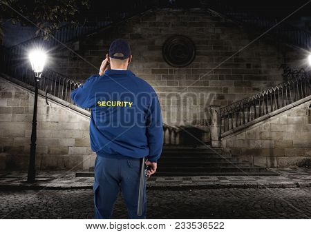 Digital composite of security guard guarding the park at night