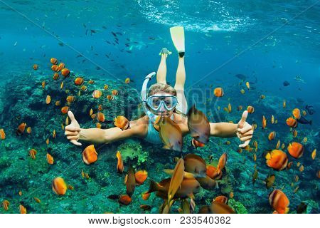Happy Family - Girl In Snorkeling Mask Dive Underwater With Tropical Fishes In Coral Reef Sea Pool.