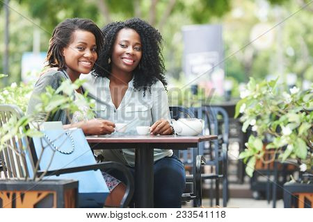 Beautiful African-american Women Drinking Tea After Shopping In Mall