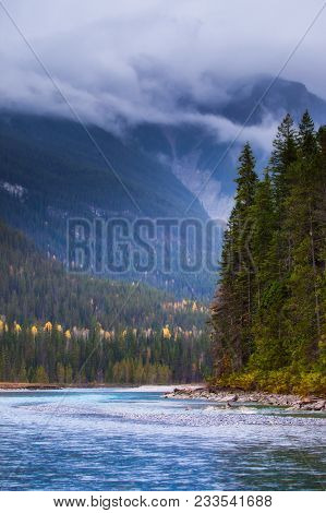 A River Flowing Through The Mountains On A Cloudy Stormy Day, British Columbia, Canada
