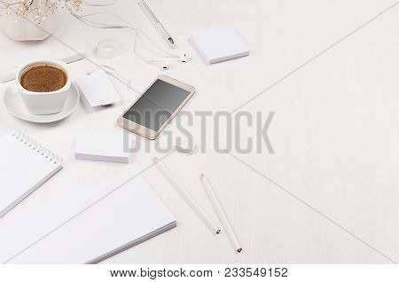 Elegant Gentle Soft White Working Place With White Stationery, Border, Phone, Coffee On White Wooden