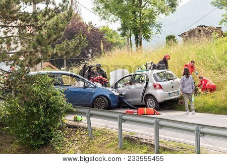 Ferrera Di Varese, Varese, Italy - June 16, 2016: Road Accident And Rescue Workers Tending To Car Ac