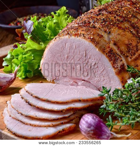 A Tasty Cooked Ham With Colorful Pfefer