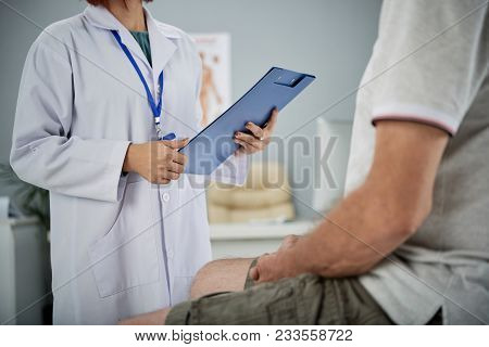 Medical Practitioner Asking Patient Questions From The List