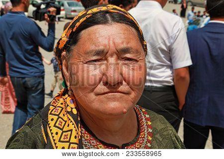 Kov-ata, Turkmenistan - April 30, 2017: An Unknown Elderly Woman In Turkmen National Clothes. Kov-at