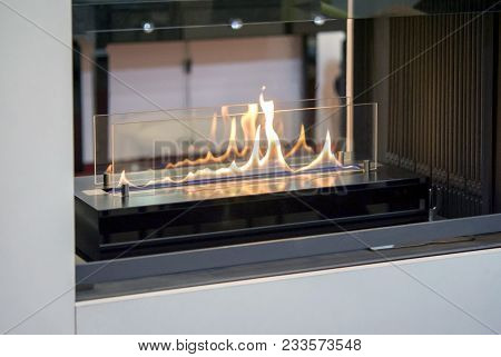 Biofireplace Burn On Ethanol Gas. Contemporary Mount Biofuel On Ethanol Fireplot Fireplace Close-up.