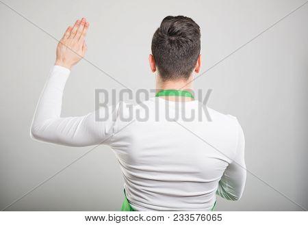 Back View Of Supermarket Employer Taking Oath.