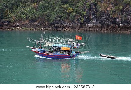 Boats Sailing Out On Halong Bay, In Vietnam, In The Mist