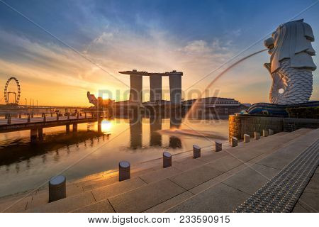 Singspore / Singapore - October 18, 2018: Singapore Skyline, business district, famous Merlion on sunrise time with real sun