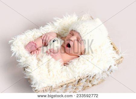 Cute sleeping newborn baby yawning