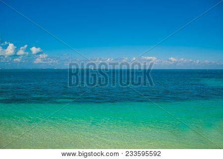 Exotic Paradise. Travel, Tourism And Vacations Concept. Tropical Resort. Caribbean Sea Jetty Near Ca