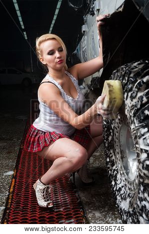 Pretty Young Girl Washing Offroad Car By Sponge