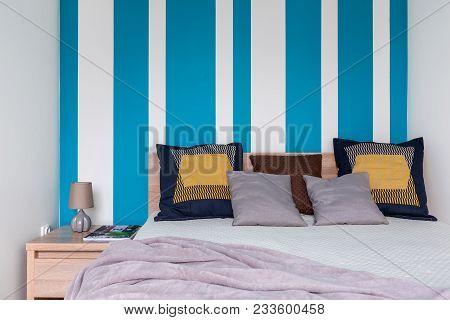Bedroom With Striped Wall