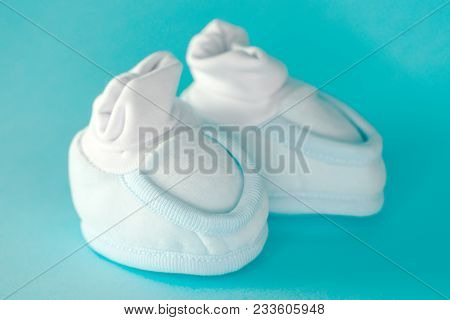 Baby Boy Booties On Blue Background, Selective Focus