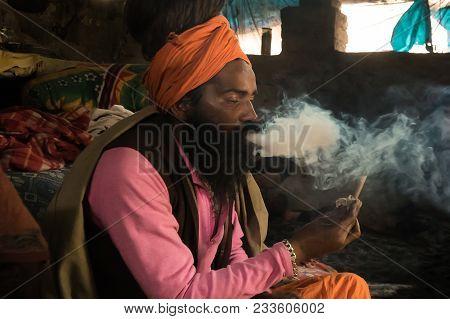 Goa, India - January 11, 2018: A Unidentified Sadhu Is Smoking Ganja Marihuana. Babba The Sacred Tea