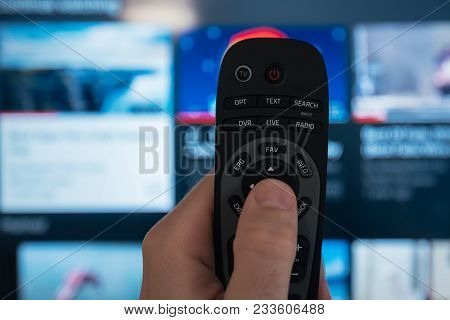 Male Hand With Smart Tv Remote Controller, Selective Focus
