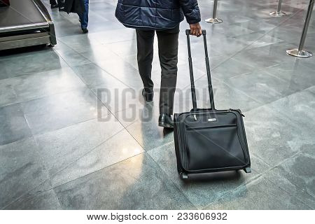 Man Traveller With Travel Suitcase Or Luggage Walking In Airport Terminal Walkway For Vacation Trave