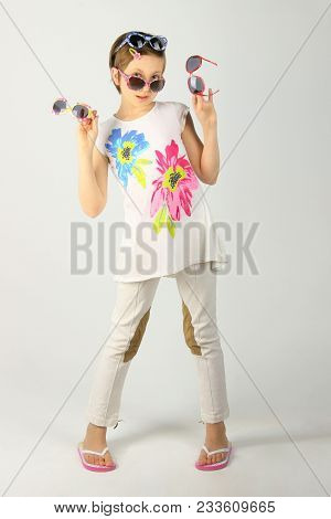 Full Length Portrait Of A Little Girl Wearing Funky Sunglasses. Young Teenage Girl Wearing Stylish S