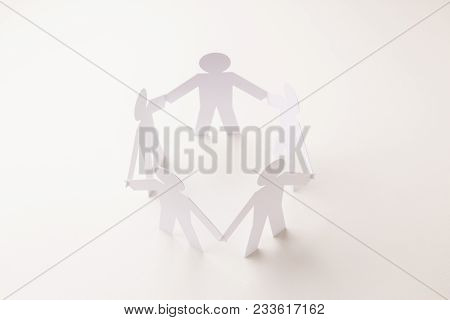 Closed Joining Of Five  Paper Figure In Hand Down Posture On Bright White Background. In Concept Of