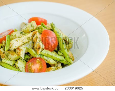 Salad With Cherry Tomatoes, Fish, Green Stems