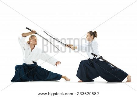 Man And Woman Fighting At Aikido Training In Martial Arts School With Saber. Healthy Lifestyle And S