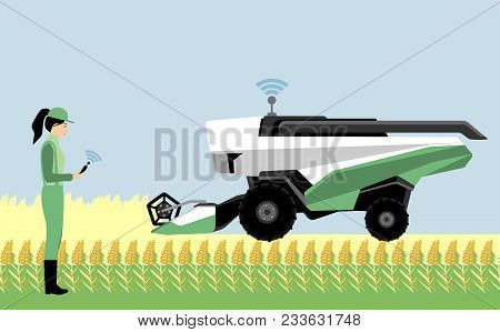 A Woman Farmer Controls An Autonomous Combine Harvester. Internet Of Things In Agriculture