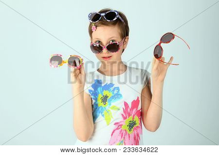 Full Length Portrait Of A Young Girl Wearing Funky Sunglasses.young Teenage Girl Wearing Stylish Sun