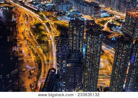 Ttop View Scene Of Hong Kong Cityscape With Traffic, Business And Modern Construction And Transporta