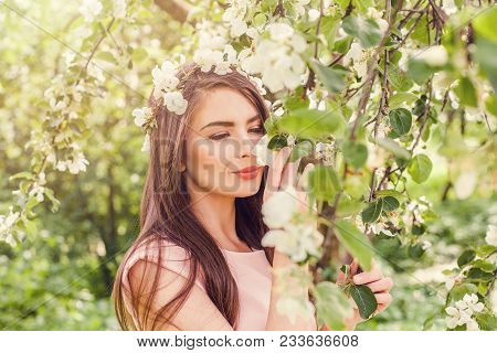 Happy Young Woman Smelling Flowers In Blossom Spring Flowers Garden