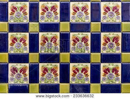 Pattern Of Multicoloured Tiles With Painted Embossed Flower Shapes