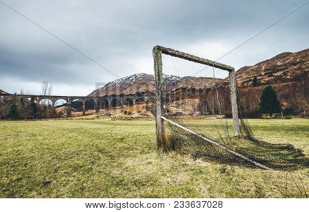 Old Soccer Gate On The Green Grass Playground Near The Famous Glenfinnan Viaduct In Scotland, United