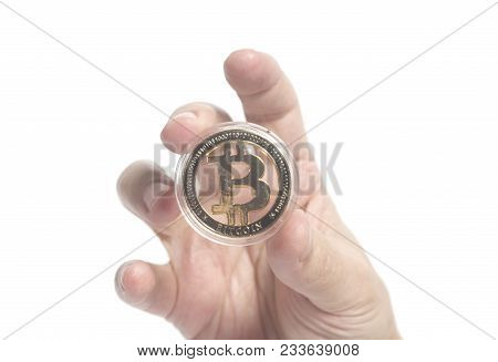 Golden Bitcoin Crypto Currency Holding Hand Isolated On A White.