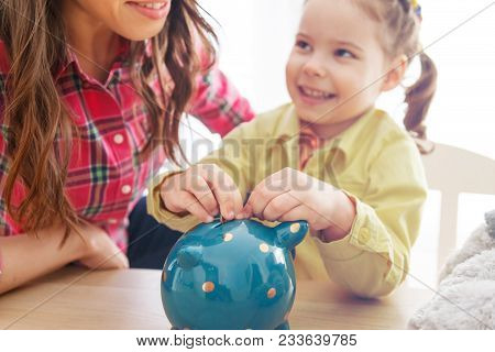 Young Mother Teaches Her Daughter To Save Money