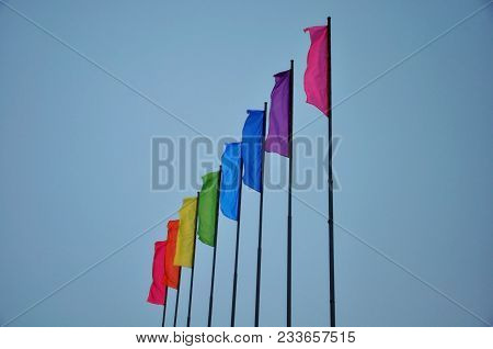 Colorful Multicolored Flags Against The Blue Sky. Many Multicolored Flags Against The Sky. The Beaut