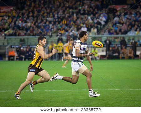 MELBOURNE - SEPTEMBER 9 : Travis Varcoe (r) in action during Geelong's win over Hawthorn - September 9, 2011 in Melbourne, Australia.