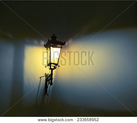 Decorative street lamps. Shadow and light on the wall. Soft focus.